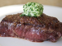 Sizzling Steak With Caramelized Onions and Herb Butter